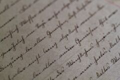 Cursive script on antique paper