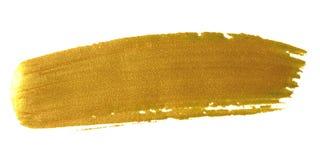 Curso da pintura da escova do ouro Mancha dourada acrílica da mancha da cor no whi fotos de stock royalty free