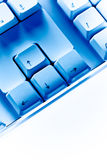 Cursor key keyboard close-up in blue ambiance Stock Photo