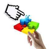 Cursor pointing at completing the puzzle. Hand holds cursor pointing at completing the puzzle Stock Image