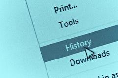 Cursore del computer che indica la storia del browser di Internet nella goccia dow Immagini Stock