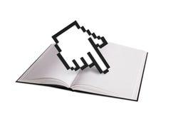 Cursore della mano e del libro aperto Fotografie Stock