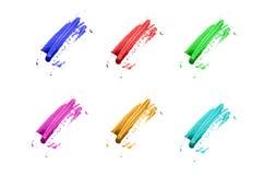 Cursos coloridos da escova em um fundo branco Imagens de Stock Royalty Free