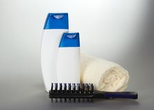 Curtailed towel hairbrush and cosmetics set Stock Photos