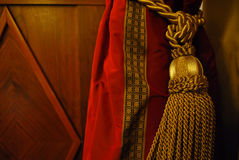 Curtain. Tied up luxury curtain with a shining Royalty Free Stock Images