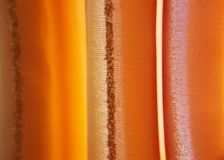 Curtain. Orange Curtain waves. Lined background Royalty Free Stock Image