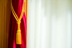 Curtain. A red curtain folded and a white background Royalty Free Stock Photo