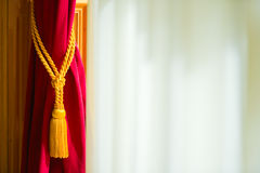 Curtain. A red curtain folded and a white background Royalty Free Stock Images