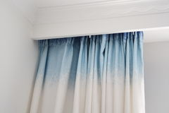 Curtain. Blue curtain in a room Royalty Free Stock Photo