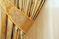 Curtain. Beautiful curtain on edge of a window Royalty Free Stock Images