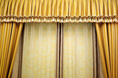 Curtain. The golden curtain in the room Royalty Free Stock Photos