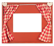 Curtain adorned photo frame on white background Royalty Free Stock Photos