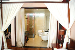 Curtain bathroom  hotel suite. A upscale hotel suite with voil curtains and bathroom Stock Photo