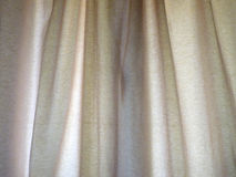Curtain. Beige curtain as a background Royalty Free Stock Photography