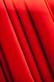 Curtain. A closed red stage curtain in a small theater Royalty Free Stock Photo