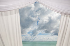 Curtain and cloudy sky Royalty Free Stock Photo