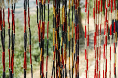 Curtain with colored strings in a bazaar Stock Photography