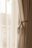 Curtain with curtain tieback Royalty Free Stock Images