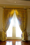Curtain on the door. Gold Curtain on the door Royalty Free Stock Photography