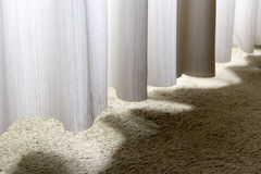Curtain, drapery, purdah, valance, valence, valency, sun, light, shadow, shadows, carpet, curves Stock Image