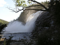Curtain of falls. Sunny curtain behind the falls - Manitou Falls, St Lawrence shores, Quebec, Canada royalty free stock photography