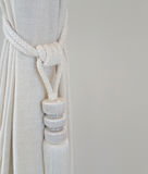 Curtain with a holding strap Royalty Free Stock Image