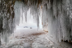 Curtain of icicles from the cave. Royalty Free Stock Photo