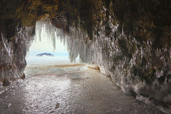 Curtain of icicles from the cave. Royalty Free Stock Image
