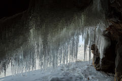 Curtain of icicles from the cave. Stock Photos