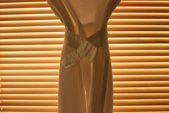 Curtain In Front Of Blinds Stock Image