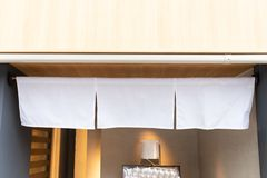 The curtain-like fabric that hangs in front of traditional Japanese restaurants royalty free stock photography