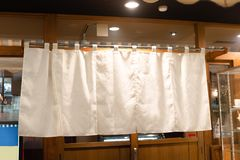 The curtain-like fabric that hangs in front of traditional Japanese restaurants. And shops not only serves as a signboard, but holds a larger meaning stock images