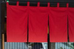 The curtain-like fabric that hangs in front of traditional Japanese restaurants. And shops not only serves as a signboard, but holds a larger meaning stock photos