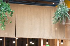 The curtain-like fabric that hangs in front of traditional Japanese restaurants. And shops not only serves as a signboard, but holds a larger meaning stock photo