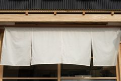The curtain-like fabric that hangs in front of traditional Japanese restaurants. And shops not only serves as a signboard, but holds a larger meaning royalty free stock photography
