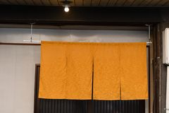 The curtain-like fabric that hangs in front of traditional Japanese restaurants. And shops not only serves as a signboard, but holds a larger meaning royalty free stock images