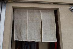 The curtain-like fabric that hangs in front of traditional Japanese restaurants. And shops not only serves as a signboard, but holds a larger meaning royalty free stock image