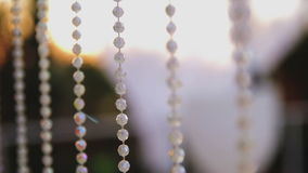Curtain made of fragments of white transparent plastic beads stock video