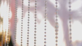 Curtain made of fragments of white transparent plastic beads stock video footage
