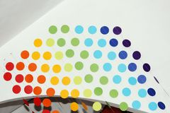 Curtain of multi-colored circles suspended on threads and attached to a plasterboard arch for indoor design. interior. Solution Stock Photo