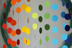 Curtain of multi-colored circles suspended on threads and attached to a plasterboard arch for indoor design. interior. Solution Royalty Free Stock Photography