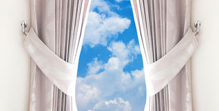 Curtain open to the  sky blue Stock Image