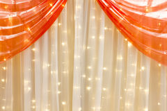 Curtain and orange lights as decoration Royalty Free Stock Photography