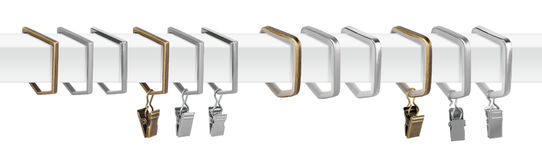 Curtain rings for eaves. Metal rings with clips for cornices. Curtain rings for eaves. Metal rings with clips for curtain cornices Stock Photo