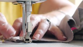 Curtain sewing process on machine. Curtain sewing process on sewing machine. Work table of tailor, processing edge tulle lace curtains stock footage