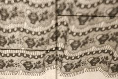 Curtain shadow on a tiled floor Royalty Free Stock Images