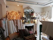 Curtain shop with rolls of fabric royalty free stock photography