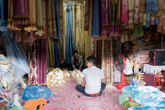 Curtain shop in Rong Kluea market. SA KAEO, THAILAND - FEBRUARY 16: Cambodian workers work in the curtain shop at Rong Kluea market on February 16, 2014 in Sa Royalty Free Stock Photos