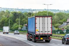 Curtain side lorry truck on uk motorway in fast motion royalty free stock images
