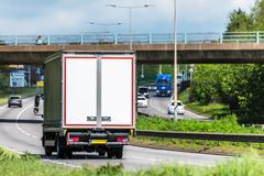 Curtain side lorry truck on uk motorway in fast motion.  royalty free stock image